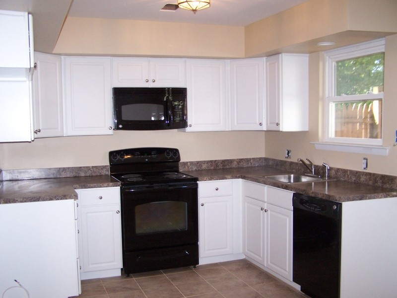 Black and white kitchen cabinets Kitchens with black appliances
