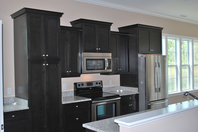 Black kitchen cabinets for Flat black kitchen cabinets